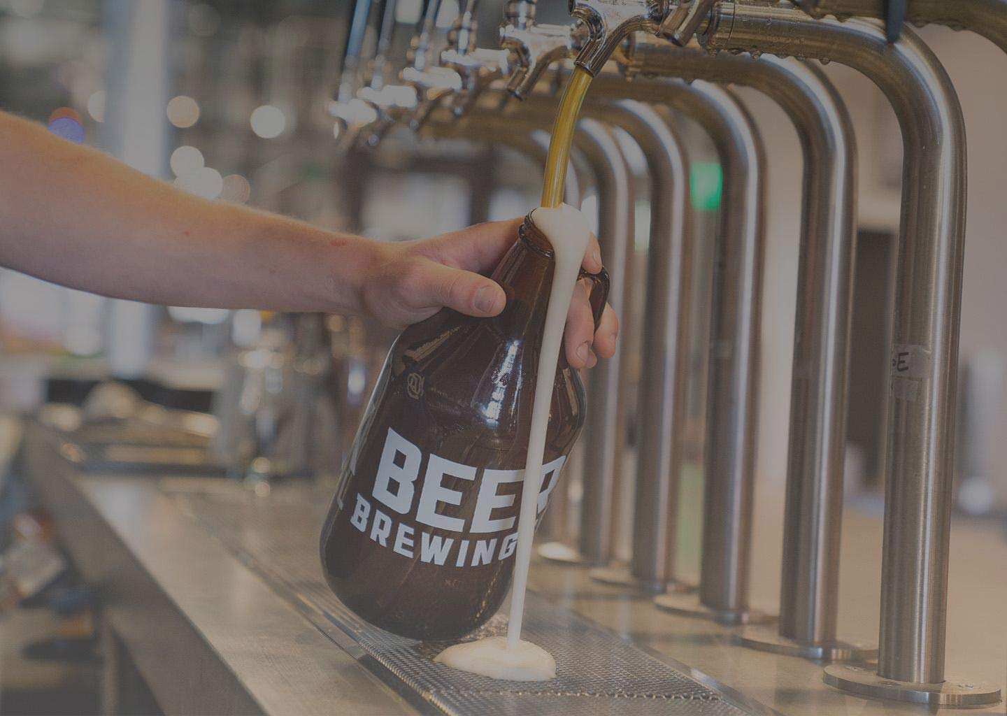 Growler glass bottle being filled with beer